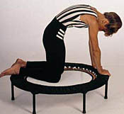 Workout on and around the mini trampoline to benefit from rebounders in many ways. Kneeling on the mini tampoline removes the load from the knees.